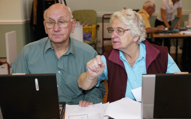 Man and woman at an over 60s computer training class