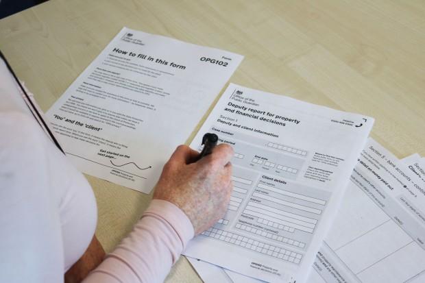 Deputy filling in report form