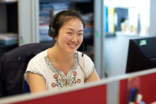 Woman on headset in contact centre